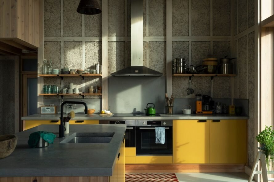 large kitchen with bright yellow cabinets