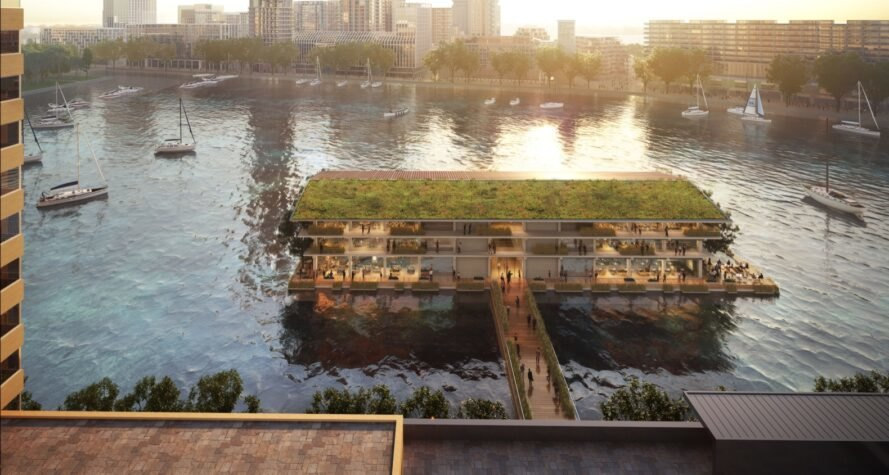 Rendering of floating office building with half a green roof and the other half of the roof covered in solar panels