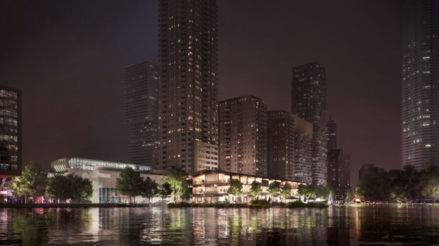 rendering of floating office building lit up at night