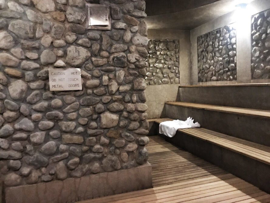 stone walls and a tired bench area for a sauna