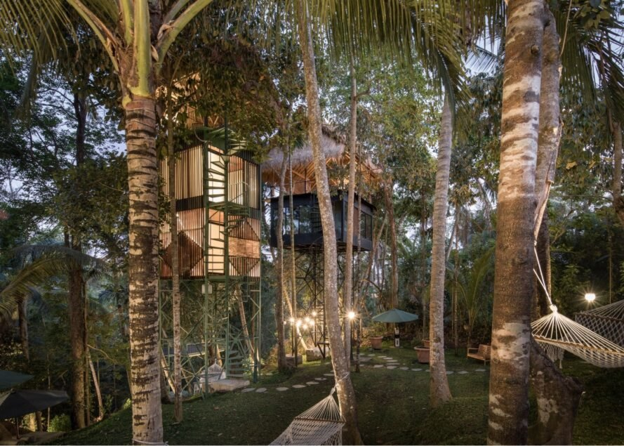 a series of treehouses in a tropical setting