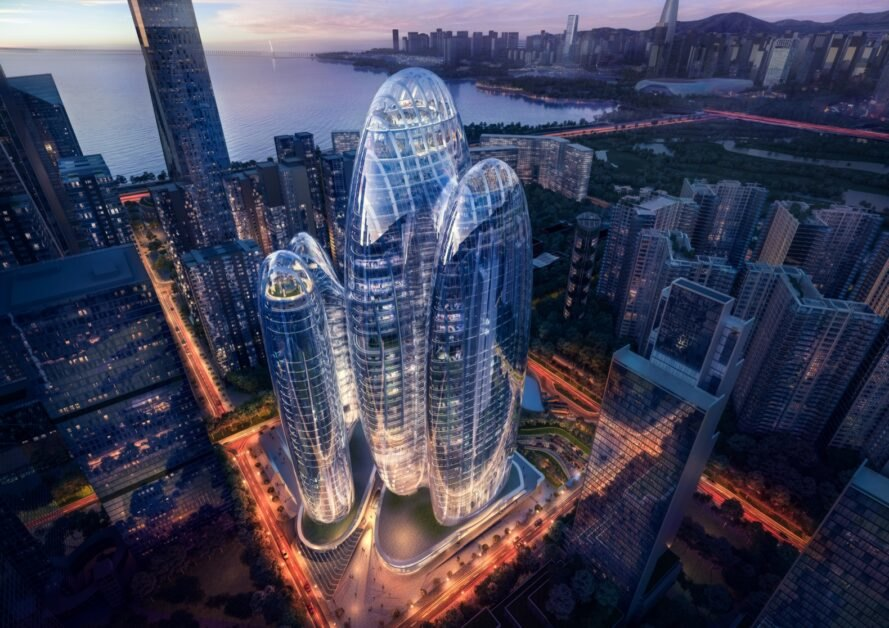 rendering of rounded towers with glass walls at night