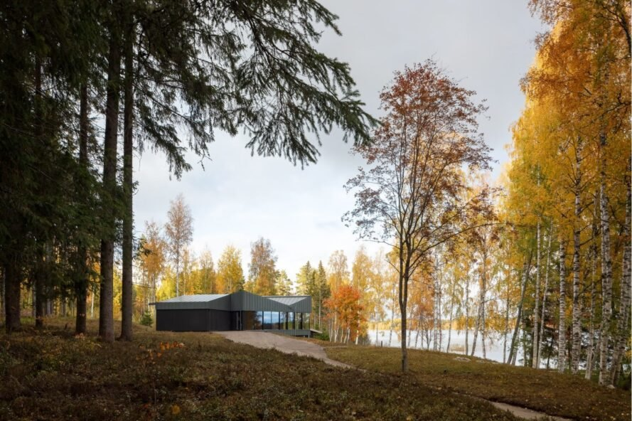 dark home with angular roof on natural landscape