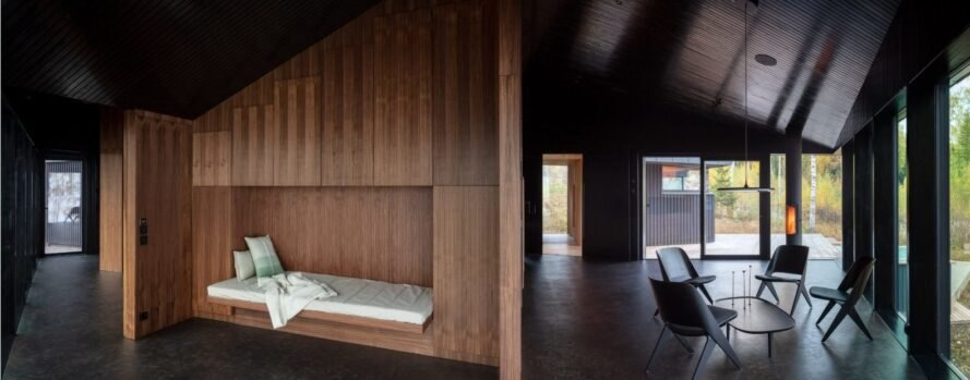 a built-in sofa bed in a wooden wall