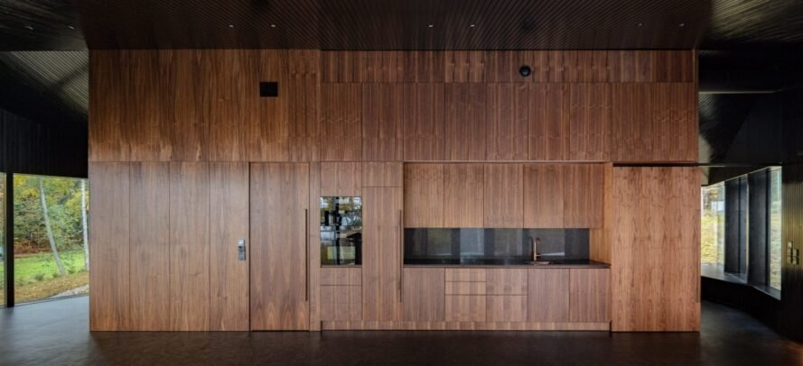 interior space with honey-toned wood walls