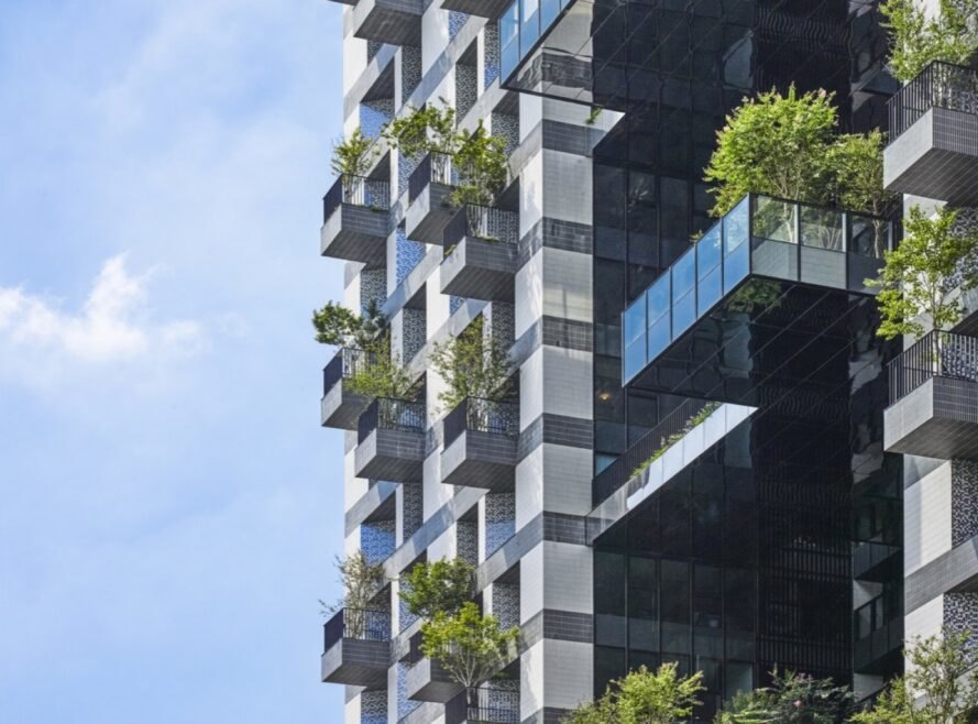 balconies covered in plants jutting out from a tower