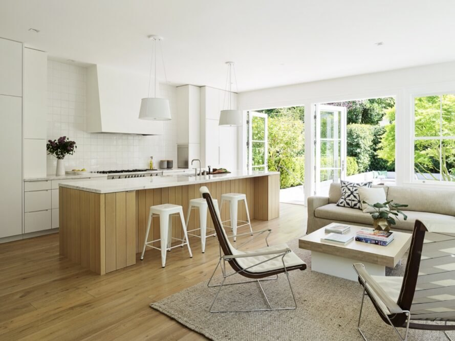 beige sofa and two chairs near wooden kitchen island