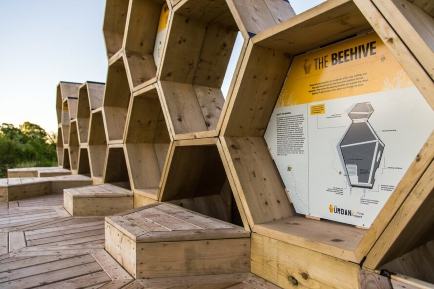 stacked wooden hexagons with yellow signs