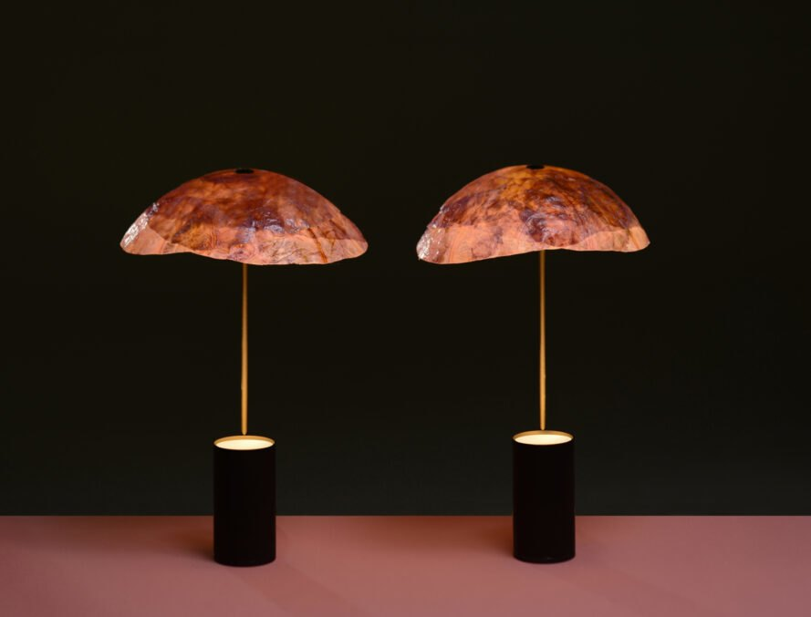 two black and gold lamps with leafy lampshades