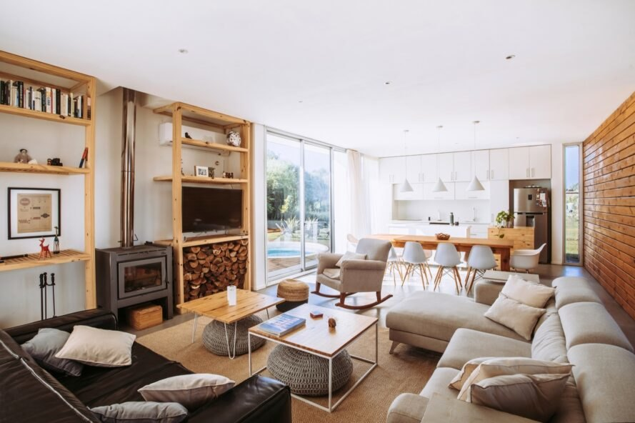 beige sofa and leather sofa around a wood-burning stove