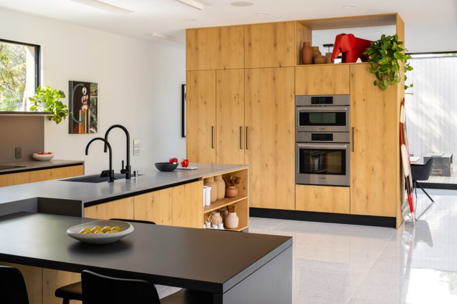 kitchen with wood cabinets and black countertops