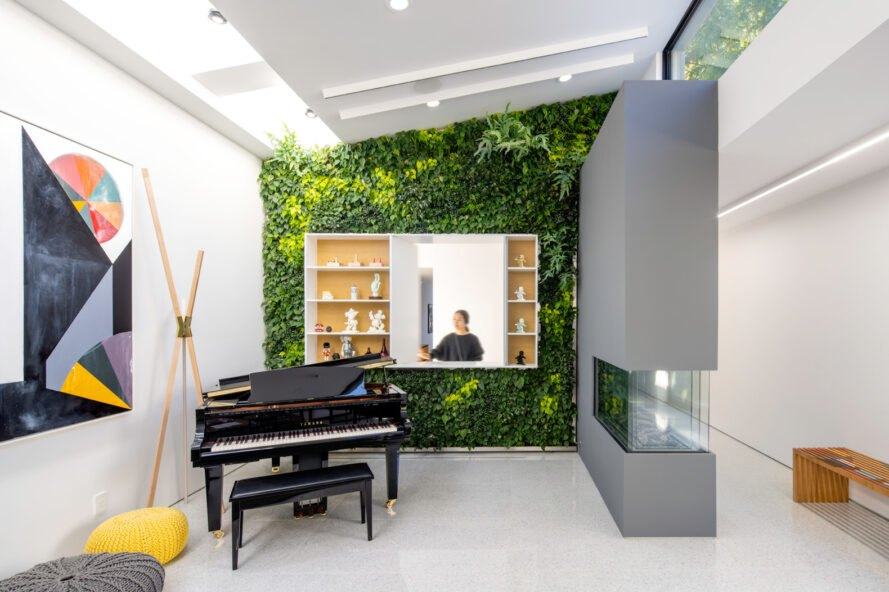 piano in front of a plant-covered wall