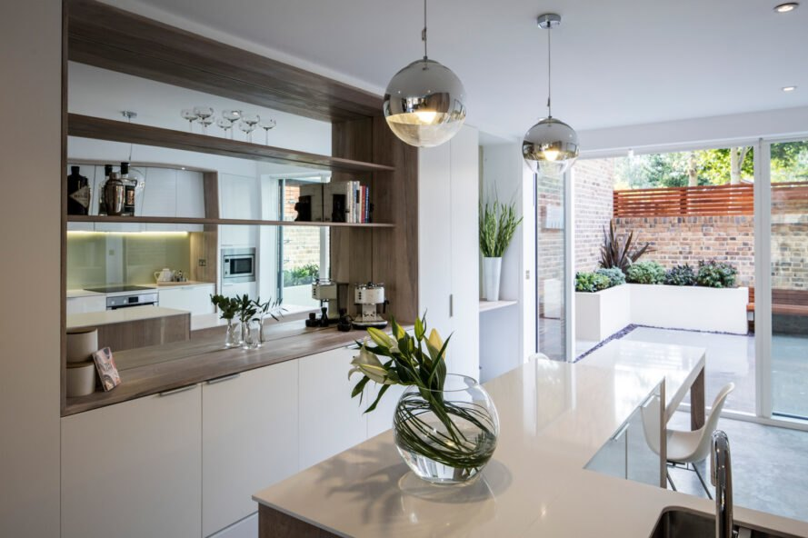 bright kitchen with white cabinets and white counters