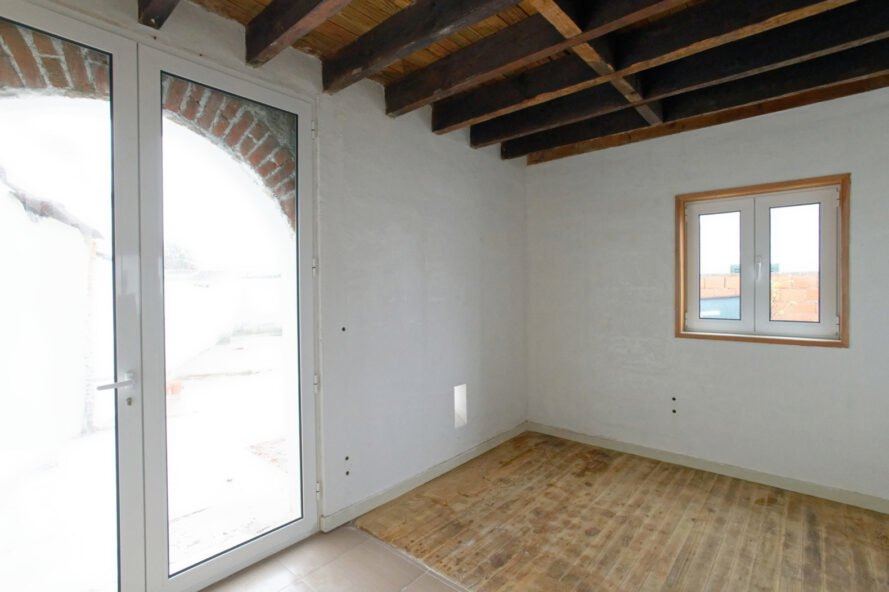 white room with glass door leading to outdoors