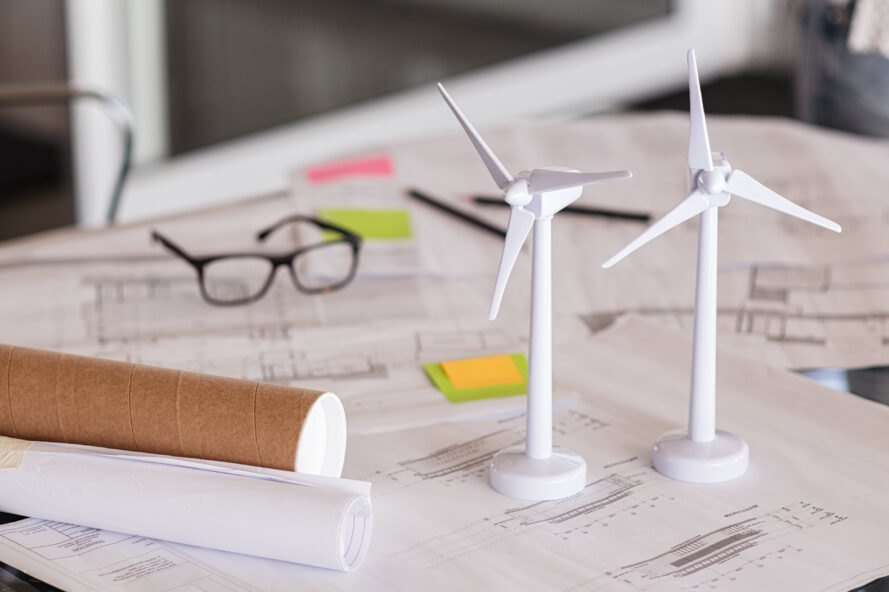 small wind turbine models and planning papers on a desk