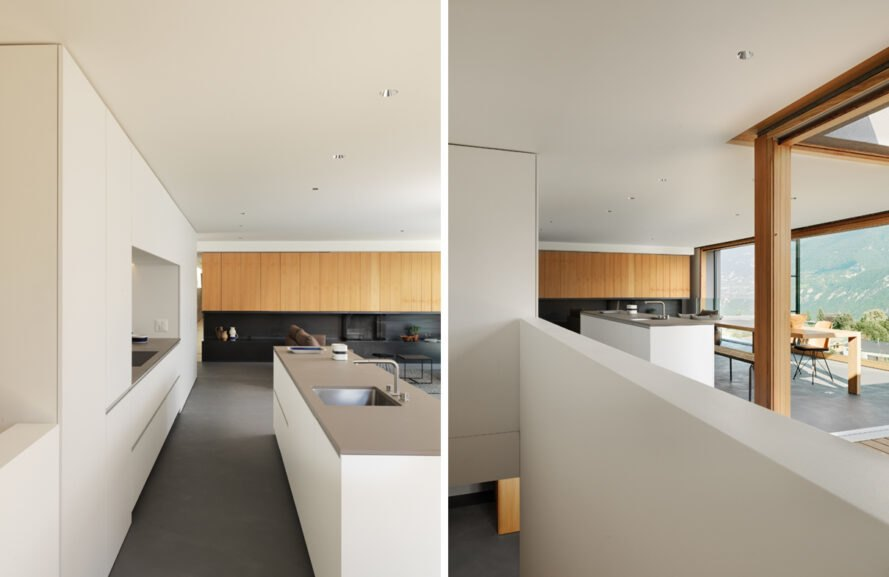 open-plan kitchen and living area with white cabinets and large windows