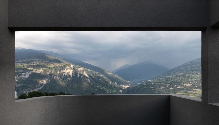 large open window overlooking mountains and valleys