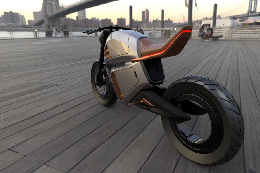 angled view from back of gray and orange hybrid motorcycle