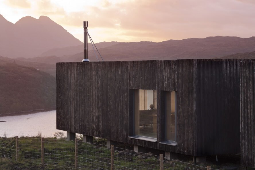 elongated timber home looking out over landscape