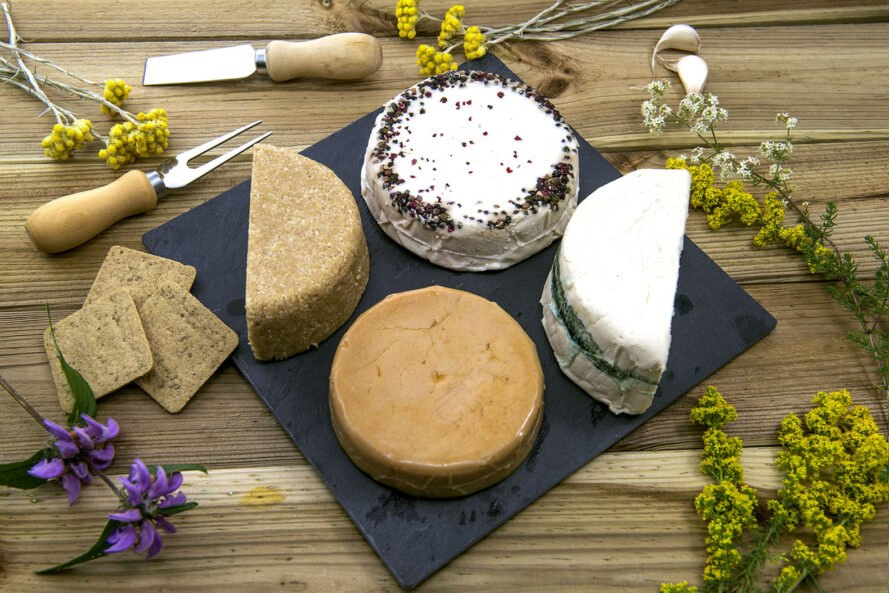 vegan cheeses on a slate board