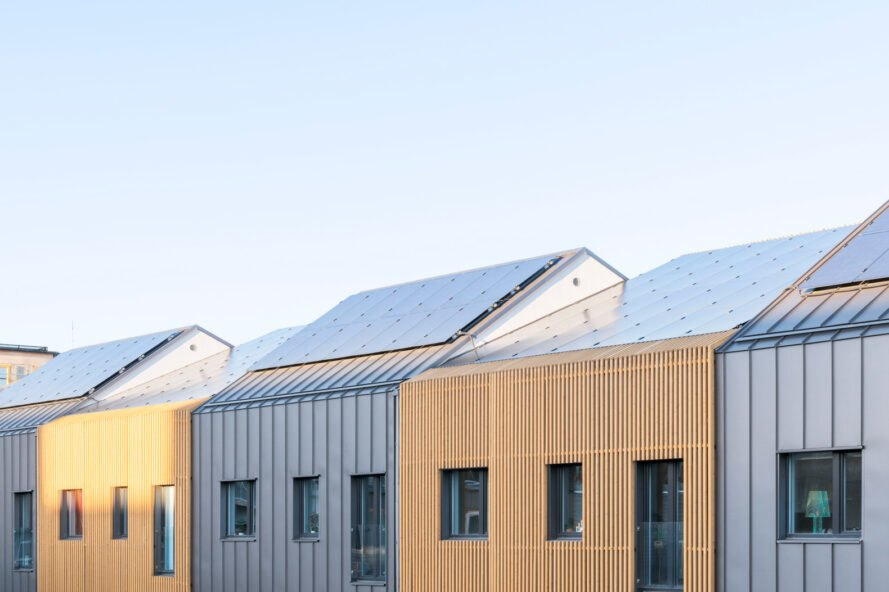 solar panels on top of wood and steel row homes