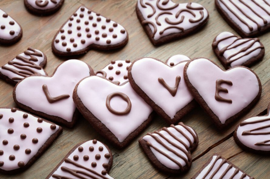 chocolate heart-shaped cookies with pink icing