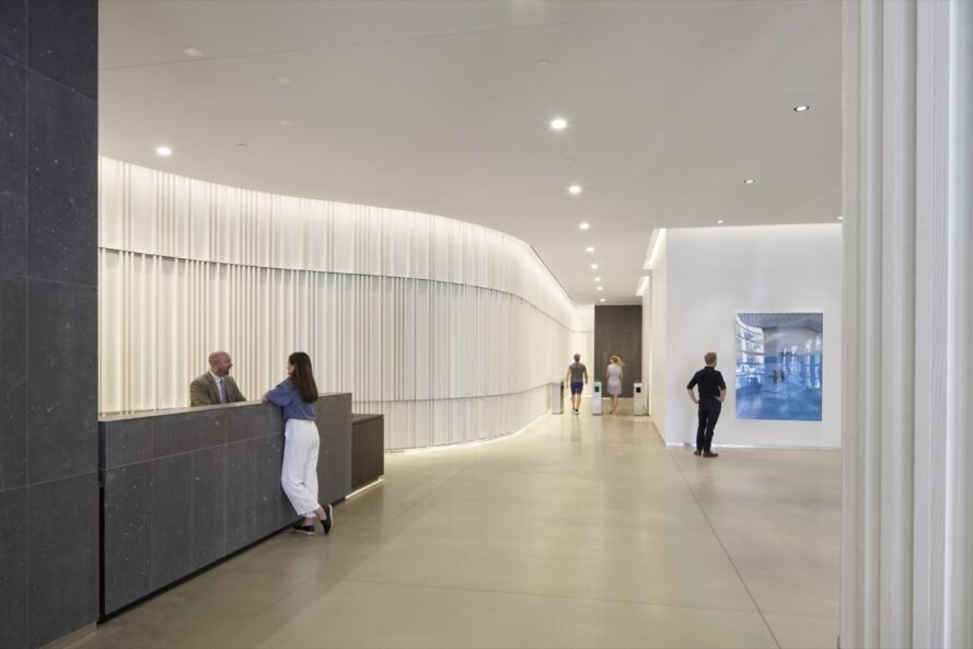 an interior lobby space with white walls and ceiling