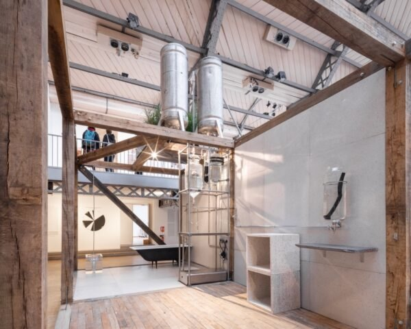 industrial design of a hotel interior with two large exposed water tanks