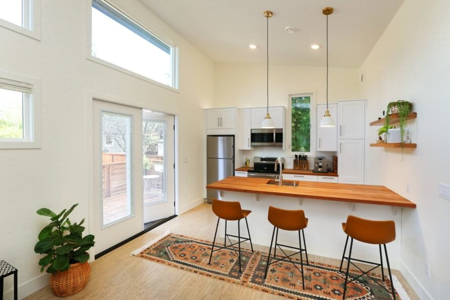 kitchen with island with three bar stools