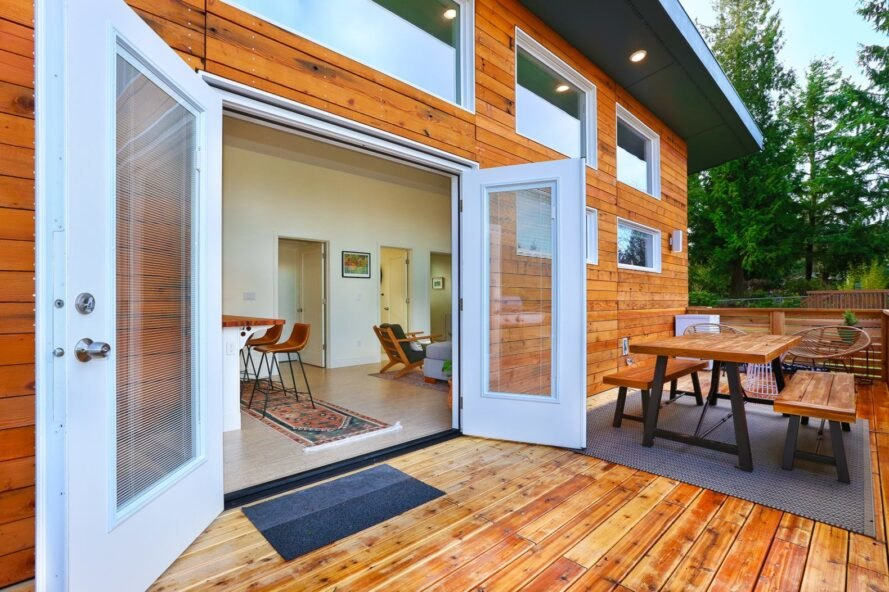 large french doors opening up to outdoor deck
