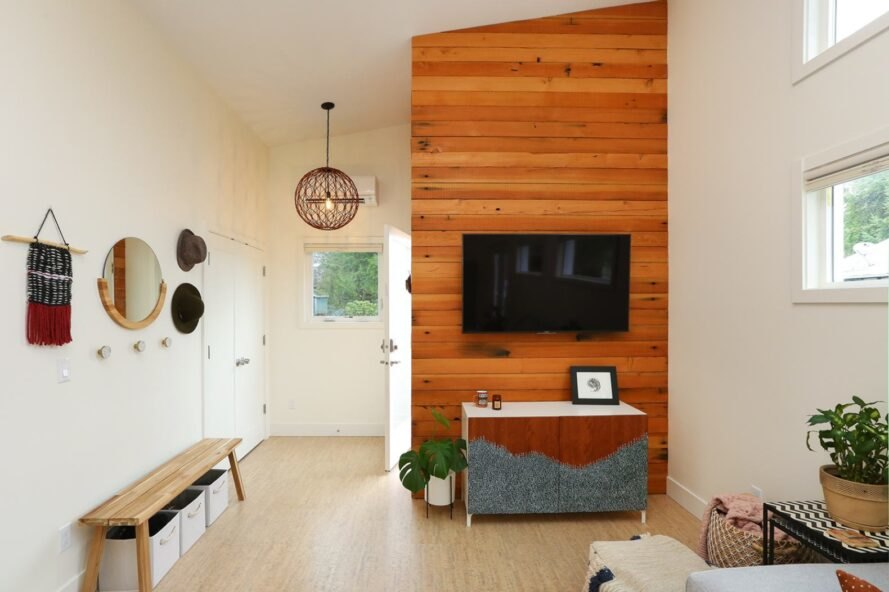 interior living space with wooden accent wall