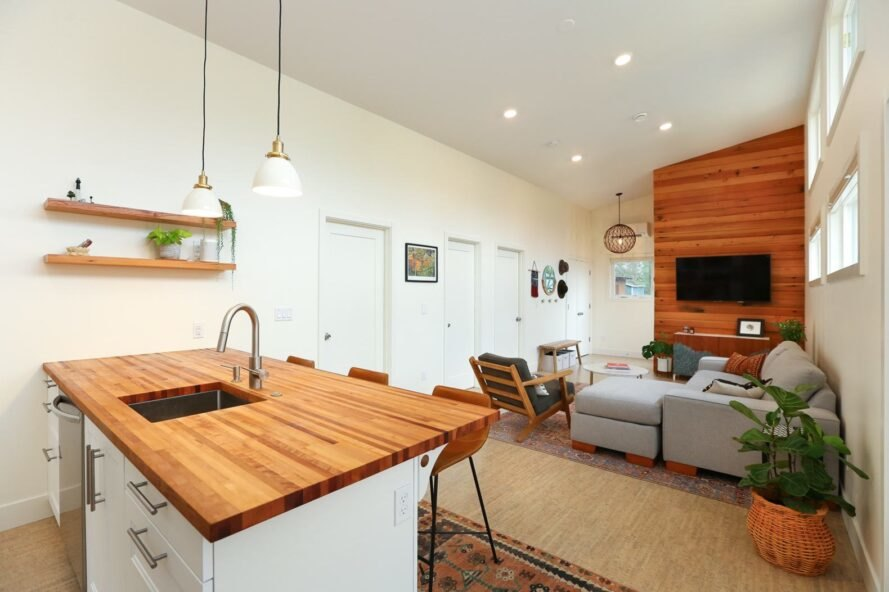 tiny home living space with wooden kitchen island