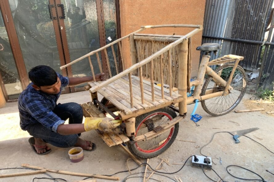 person building a bamboo bike