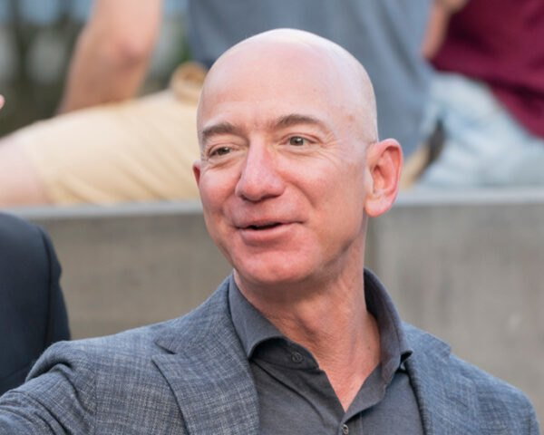 Jeff Bezos waving to photographers