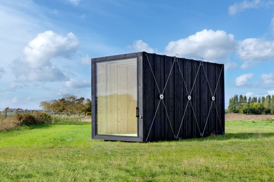 rectangular black cabin with glass entrance
