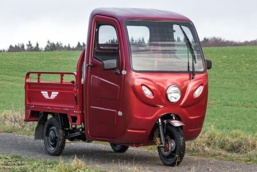 red electric truck with three wheels