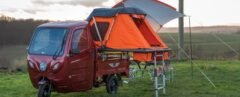 red camper with orange tent