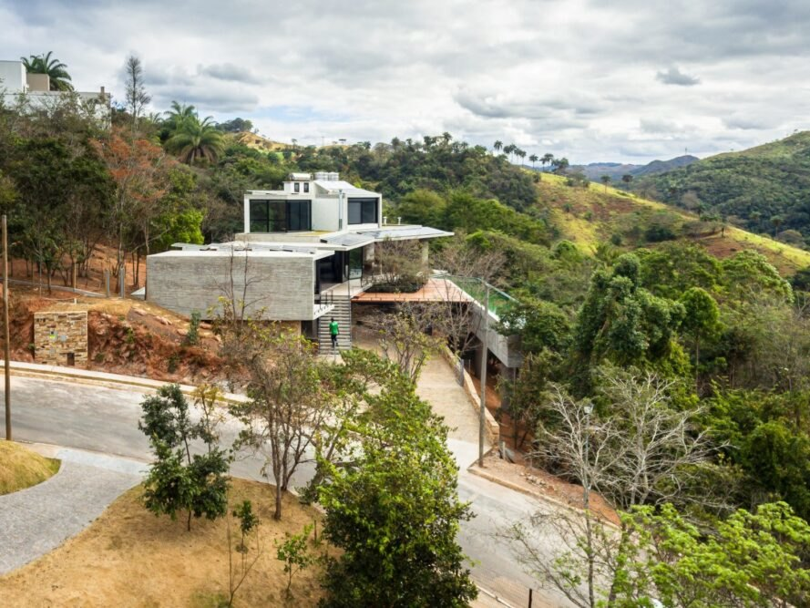 large home on a hill surrounded by greenery