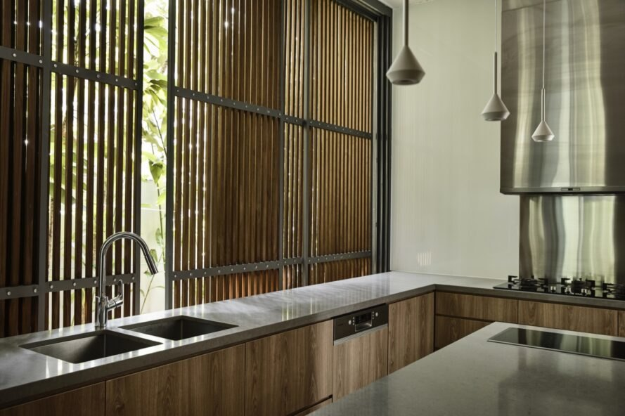 timber kitchen with windows covered by timber slats