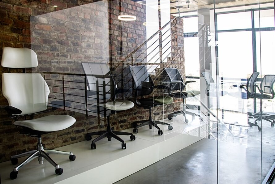 interior office space with brick walls and glass