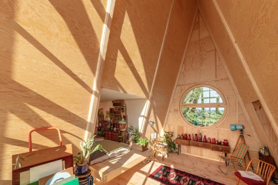wood-lined interior of A-frame cabin