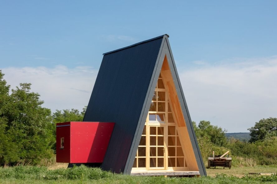 dark triangular cabin with red box to one side