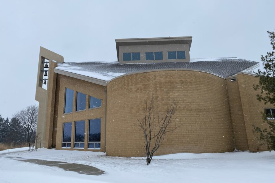 the exterior of Holy Wisdom in the snow. the building has a tan facade with angular windows