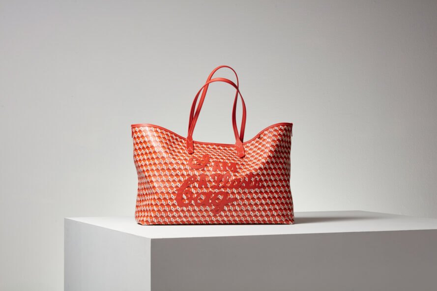 red tote bag on white cube