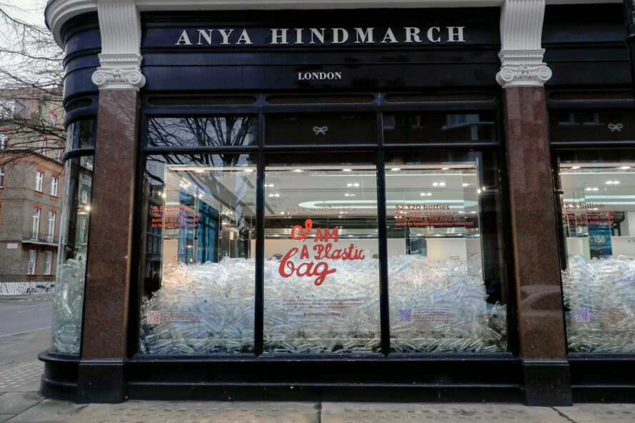 Anya Hindmarch storefront filled with empty plastic water bottles
