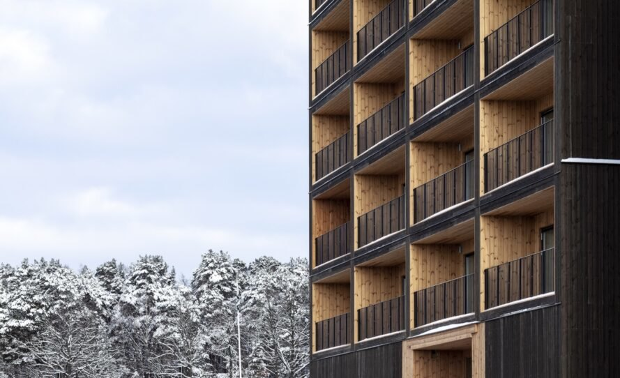 angled view of balconies on a wood building