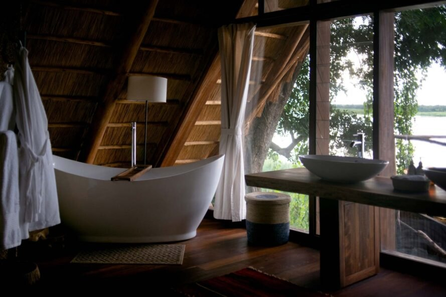 a large soaking tub adjacent to a window