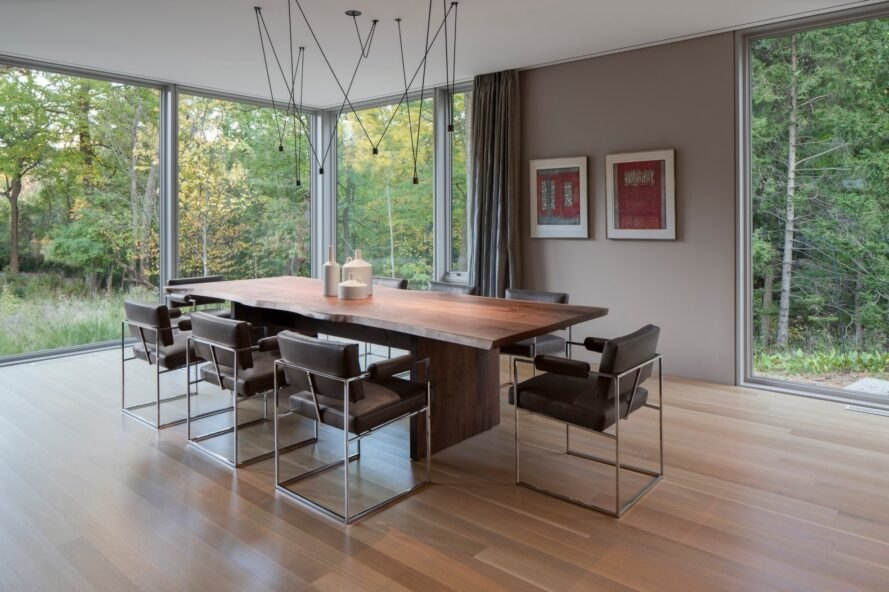 wood dining table near full-height windows