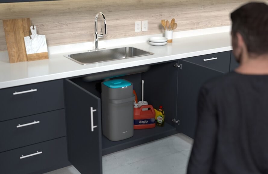 gray and blue compost bin under kitchen sink