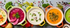 colorful vegan soups on gray background